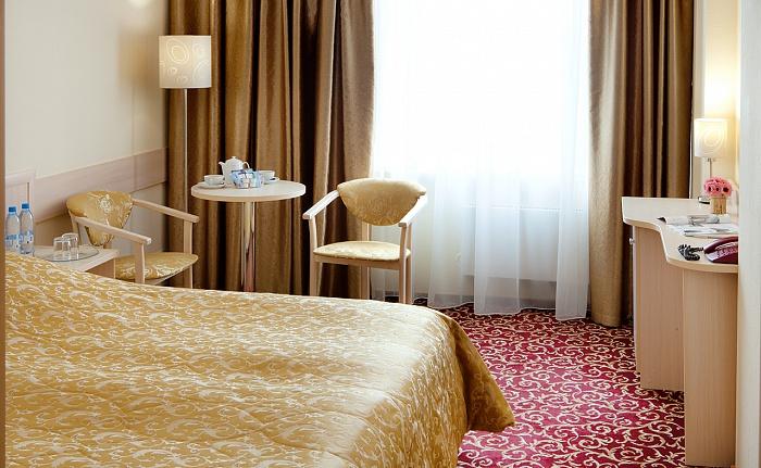 Комфортный номер первого класса в гостинице Бета